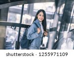 attractive young asian woman... | Shutterstock . vector #1255971109