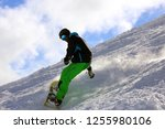 snowboarder riding the slope | Shutterstock . vector #1255980106
