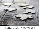 puzzle on wooden boards team... | Shutterstock . vector #125599523