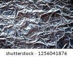 wrinkled aluminum foil... | Shutterstock . vector #1256041876