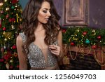 woman at christmas | Shutterstock . vector #1256049703