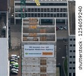 Small photo of 14 November 2018, Amsterdam, Holland. Aerial view of top floor of European Medicines Agency EMA at the Zuidas in Amsterdam. Builders are Heijmans and Dura Vermeer and have reached the highest point.