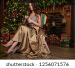 woman at christmas  | Shutterstock . vector #1256071576