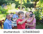 in the summer  a family of...   Shutterstock . vector #1256083660