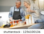 senior couple couple cooking... | Shutterstock . vector #1256100136