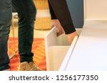 close up hand opens the shelf... | Shutterstock . vector #1256177350