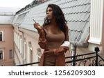 beautiful lady in beige slim... | Shutterstock . vector #1256209303