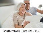 senior married couple relaxing... | Shutterstock . vector #1256210113