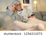 senior couple at home relaxing ... | Shutterstock . vector #1256211073