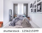 Stock photo cozy king size bed with grey bedding and warm blanket in elegant bedroom interior with mirror and 1256215399