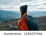 a woman in a jacket and a hat... | Shutterstock . vector #1256237446