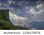 mountain view misty morning of... | Shutterstock . vector #1256270476