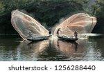 Fishermen Throw A Fishing Nets. ...