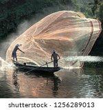 fishermen throw a fishing nets. ... | Shutterstock . vector #1256289013