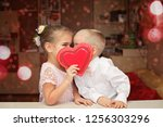 Stock photo little boy in white shirt and soft pink bow tie and beautiful little princess wearing soft pink 1256303296