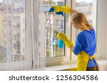 young woman in yellow gloves... | Shutterstock . vector #1256304586