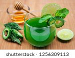 juice of bitter gourd with raw... | Shutterstock . vector #1256309113