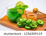 juice of bitter gourd with raw... | Shutterstock . vector #1256309119