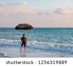 a barefooted boy plays at the... | Shutterstock . vector #1256319889