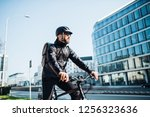 Male Courier With Bicycle...