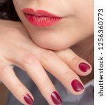 girl's hand with red manicure... | Shutterstock . vector #1256360773