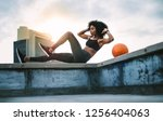 side view of a female athlete... | Shutterstock . vector #1256404063