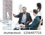 business team in the workplace... | Shutterstock . vector #1256407723