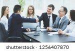 business partners shaking hands ... | Shutterstock . vector #1256407870