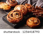 freshly baked sweet buns on... | Shutterstock . vector #1256418793