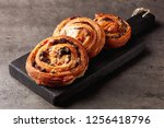 freshly baked sweet buns on... | Shutterstock . vector #1256418796