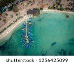boat dock on the beach | Shutterstock . vector #1256425099