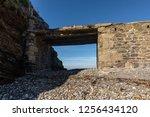 dyke bridge in ruins towards an ...   Shutterstock . vector #1256434120