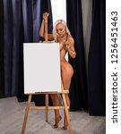 beautiful blonde nude girl... | Shutterstock . vector #1256451463