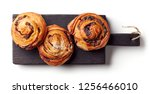 freshly baked sweet buns on... | Shutterstock . vector #1256466010