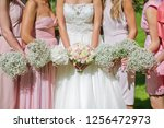 bridesmaids with bouquets | Shutterstock . vector #1256472973
