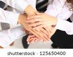 business team putting their... | Shutterstock . vector #125650400