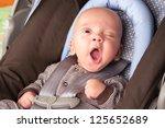 Portrait Of A Yawning Baby Boy...