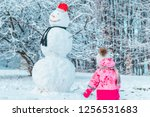 little gild kid in pink winter... | Shutterstock . vector #1256531683