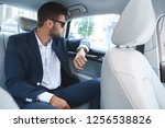a businessman in the back seat  ... | Shutterstock . vector #1256538826