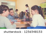 happy pupils chattering sitting ... | Shutterstock . vector #1256548153