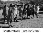 unidentified maasai men on oct... | Shutterstock . vector #1256549209