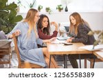 a group of three women are... | Shutterstock . vector #1256558389