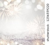 gold and silver fireworks and... | Shutterstock . vector #1256559220