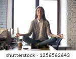 serene calm business woman sit... | Shutterstock . vector #1256562643