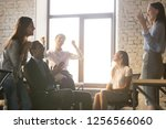 excited diverse team people... | Shutterstock . vector #1256566060