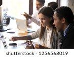 diverse millennial employees... | Shutterstock . vector #1256568019