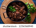 jug of goulash beef stew with... | Shutterstock . vector #1256568940