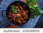 jug of goulash beef stew with... | Shutterstock . vector #1256568943