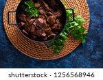 jug of goulash beef stew with... | Shutterstock . vector #1256568946