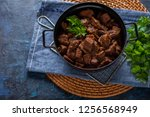 jug of goulash beef stew with... | Shutterstock . vector #1256568949